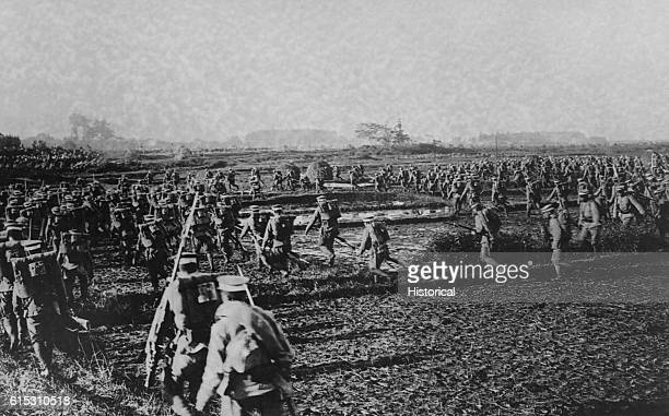 Japanese soldiers charge on Bolshevik positions in Siberia during the civil war between Red and White Russian forces after the 1917 Revolution. Ca....