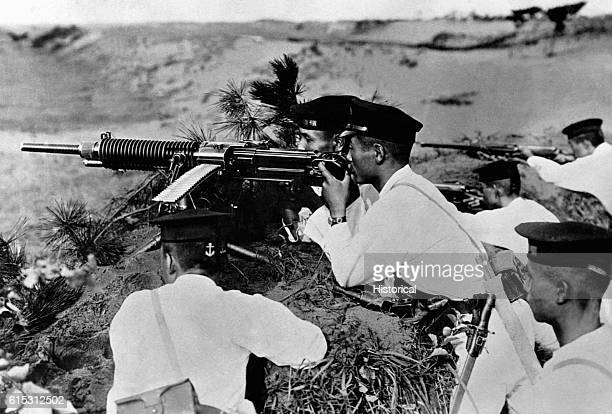 Japanese soldiers man a heavy machine gun against invading American forces on Guadalcanal Island This picture was found in the belongings of a...
