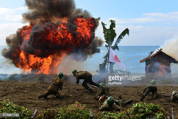 Japanese soldiers played by Talisay City College students take cover from the huge explosion during the Landing Reenactment at Talisay City Cebu...
