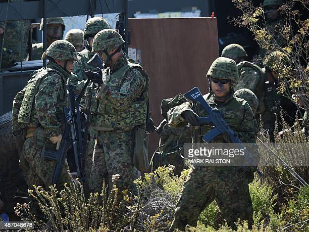 Japanese soldiers prepare at their base before an amphibious landing operation with US Forces and the Japan Maritime SelfDefense Force at the Dawn...