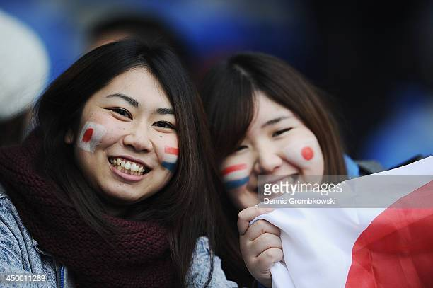 Japanese spectators cheer prior to the International Friendly match between the Netherlands and Japan on November 16 2013 in Genk Belgium