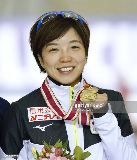 Japanese speed skater Nao Kodaira poses with her gold medal after winning the women's 500meter race in the World Cup opener in Obihiro Hokkaido on...