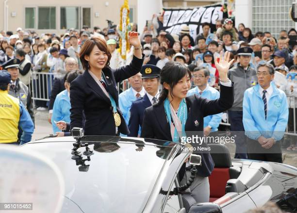 Japanese speed skaters Miho Takagi and her older sister Nana team pursuit gold medalists at the Pyeongchang Winter Olympics in South Korea wave to...