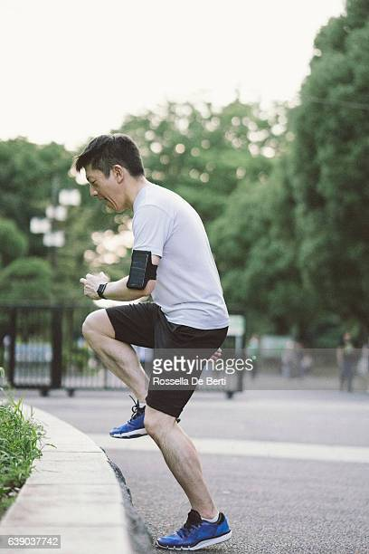 Japanese sport man exercising in a park