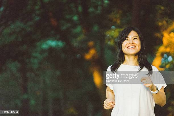 Japanese Sport Woman Exercising Outdoors In The Early Morning