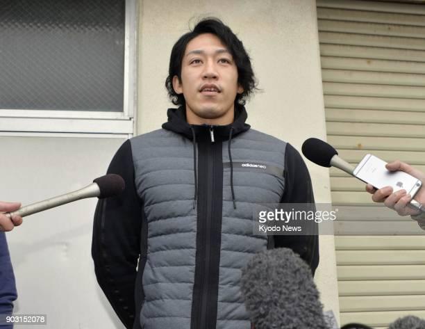 Japanese sprint canoeist Seiji Komatsu speaks to reporters in Komatsu Ishikawa Prefecture on Jan 10 2018 Komatsu failed a doping test after fellow...
