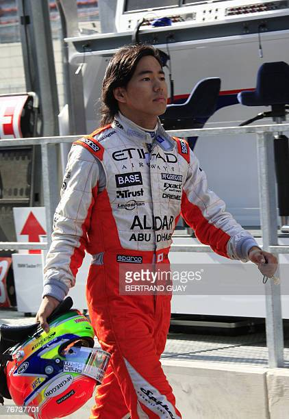 Japanese Spyker MF1 driver Sakon Yamamoto walks in the pits of the SpaFrancorchamps racetrack 14 September 2007 in Spa during the first practice...