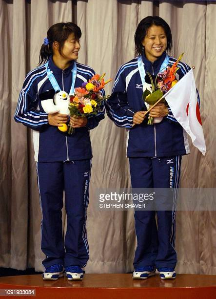 Japanese stand on the podium after winning the team bronze medal in the women's synchronized diving finals 09 October 2002 during the 14th Asian...
