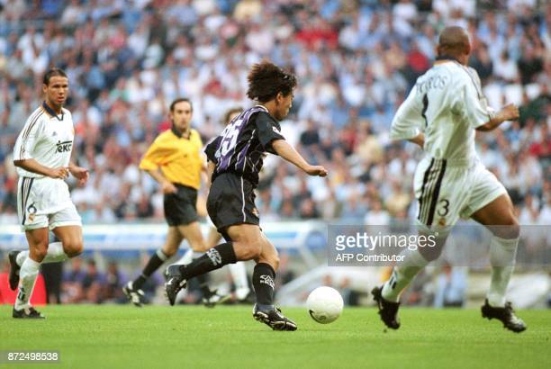 Japanese striker of the Real Valladolid Shoji Jo fights for the ball with Real Madrid Argentine Fernando Redondo and Brazilian Roberto Carlos late 19...