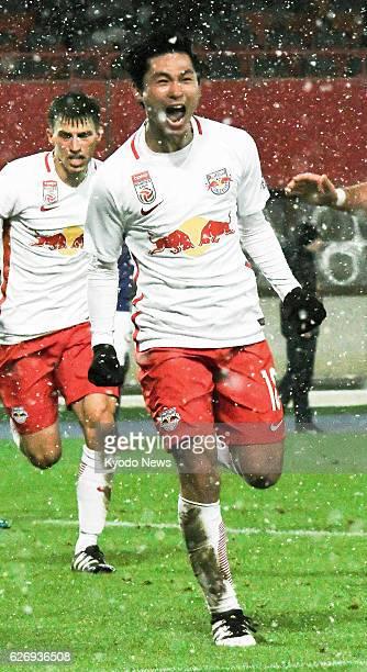 Japanese striker Takumi Minamino celebrates after scoring Salzburg's third goal in their 31 away win at Austria Vienna in the Austrian first division...