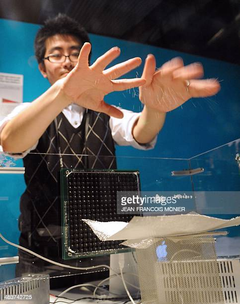 Japanese student from the College of Image Arts and Sciences of the Ritsumeikan University in Kyoto uses sound waves to levitate polystyrene balls on...
