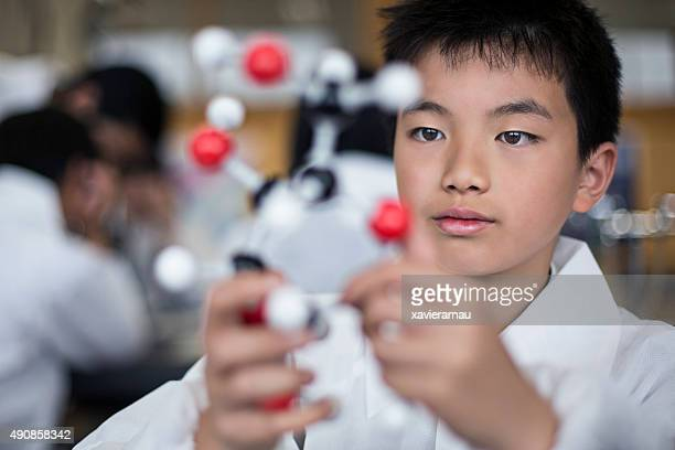 Japanese student holding a molecular model