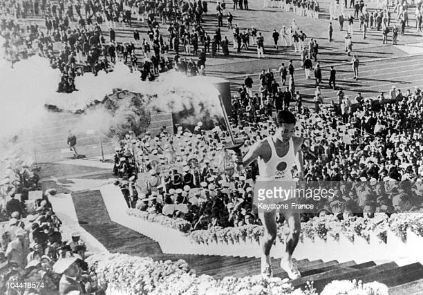 Japanese Student Yoshinori Sakai Holding The Olympic Flame For The Opening Ceremony Of The Olympic Games Of Tokyo On October 11, 1964. The Ceremony...