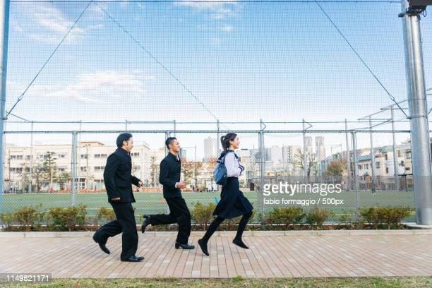 japanese students meeting outdoors - 歩道橋 ストックフォトと画像