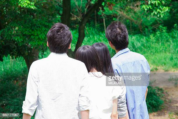 Japanese students stand in grassland