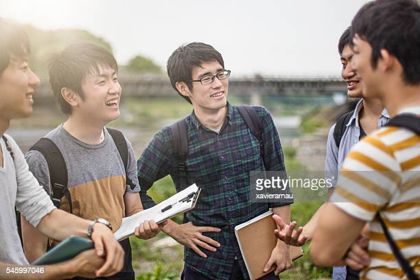 Japanese students talking outdoors in the university