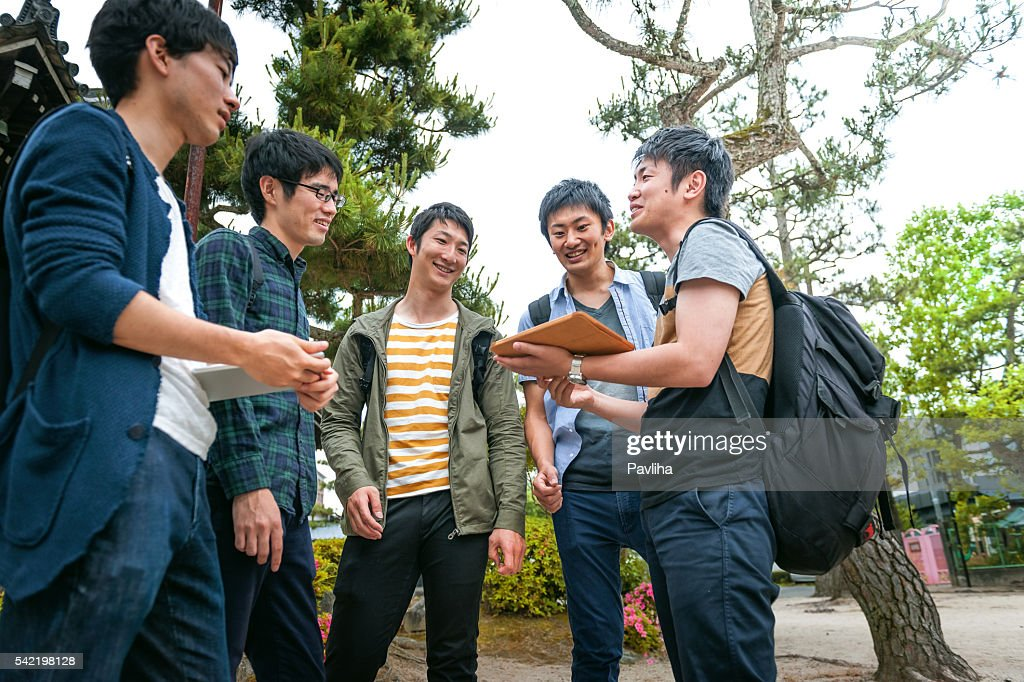 Japanese students together with friend checking telephone in Kyoto,Japan : Stock Photo