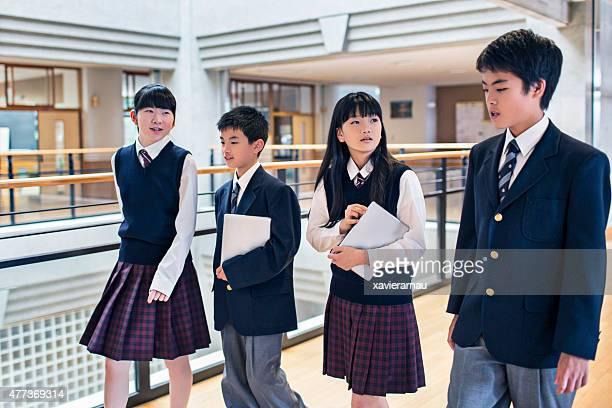Japanese students walking in the school corridors