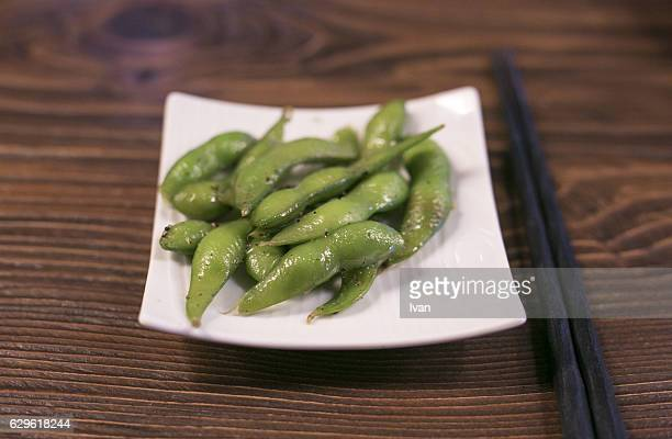 Japanese Style, Boiled Soybeans On Plate with Chopsticks