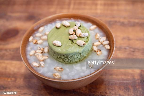 japanese style dessert, sweet pearl barley soup with green tea, matcha tea ice cream and rice dumpling - mochi stock photos and pictures