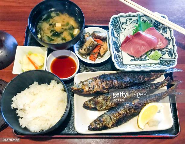 Japanese style lunch meal, grilled sardines and yellowtail sashimi