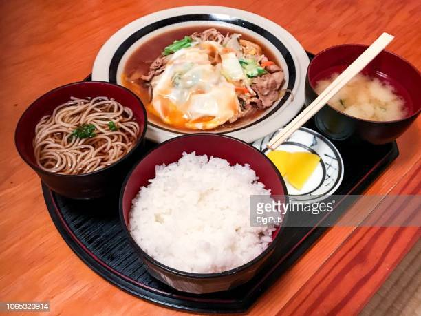 japanese style lunch meal, pork and vegetable with egg poured - takuan stock photos and pictures