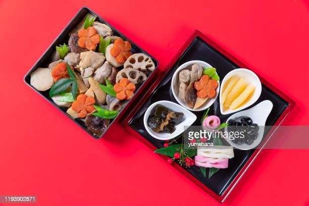 japanese style new year's meal called osechi - osechi ryori stock pictures, royalty-free photos & images