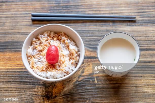 japanese style preserved fruits tomato with rice and miso soup - ciruela fotografías e imágenes de stock