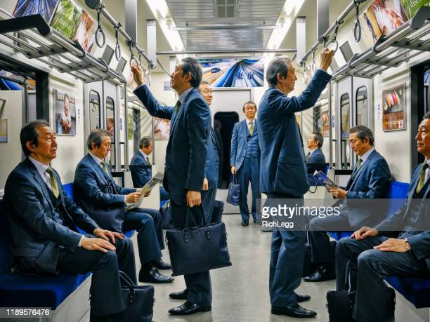 japanese subway train filled by one man - cloning stock pictures, royalty-free photos & images