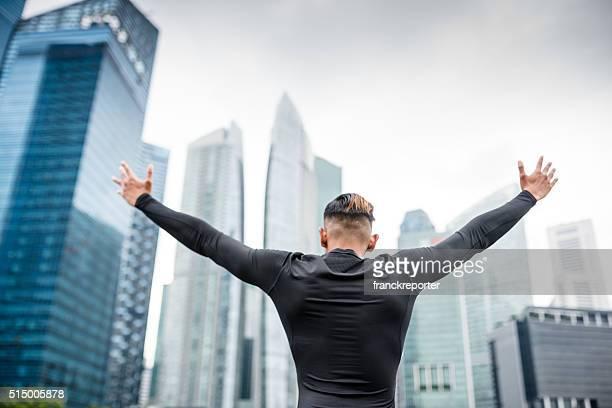 japanese success man praying on the downtown