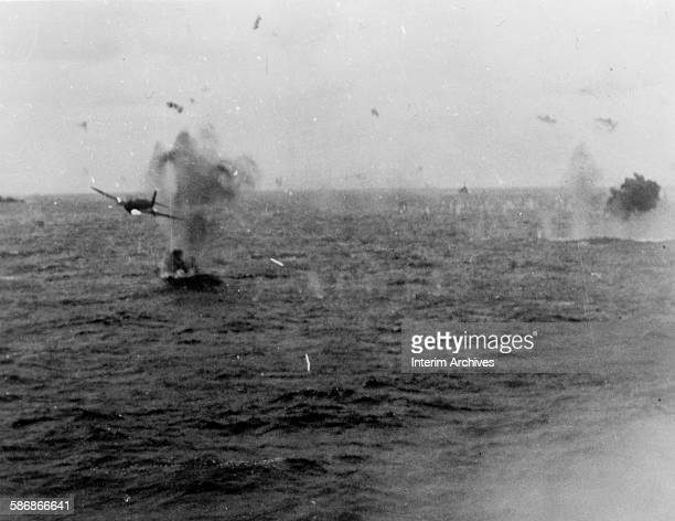 Japanese suicide plane or kamikaze attacks the US Navy cruiser USS Santa Fe off Formosa , 1944.