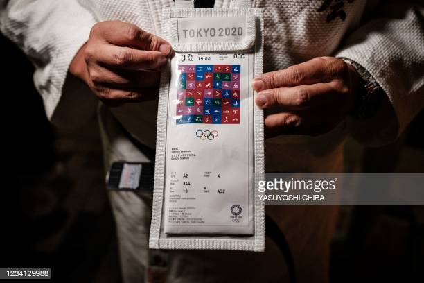 Japanese super fan Kazunori Takishima who has been to every summer and winter Games in the past 15 years and bought 197 tickets for himself and...
