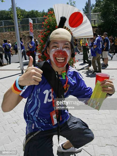 A Japanese supporter is proudly presenting his world cup ticket in front of the world cup stadium in Kaiserslautern on Monday June 12th 2006...