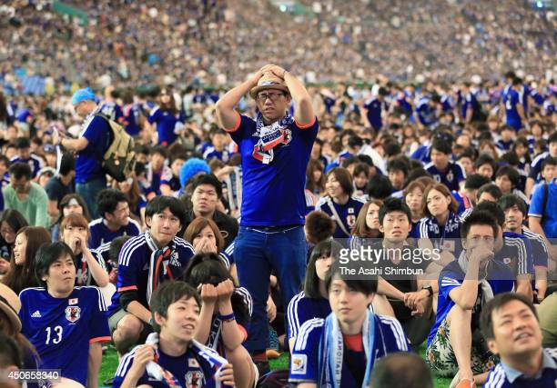 Japanese supporter shows his dejection as Japan lost to Cote D'Ivoire during the public viewing at the Tokyo Dome on June 15 2014 in Tokyo Japan