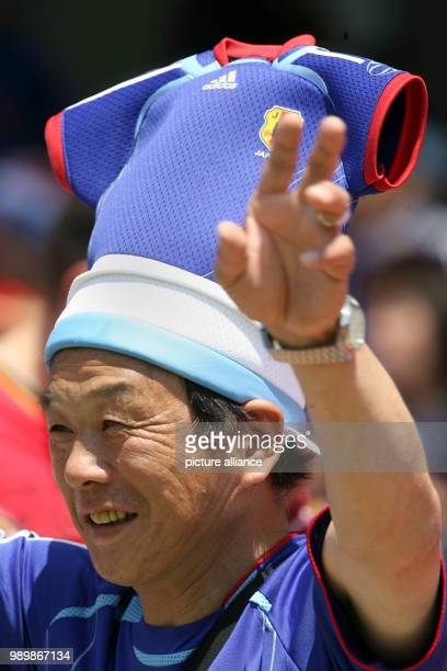 A Japanese supporter with unusual headgear is working the crowd at the FIFA world cup stadium in Nuremberg on June 18th 2006 Japan plays a 00 against...