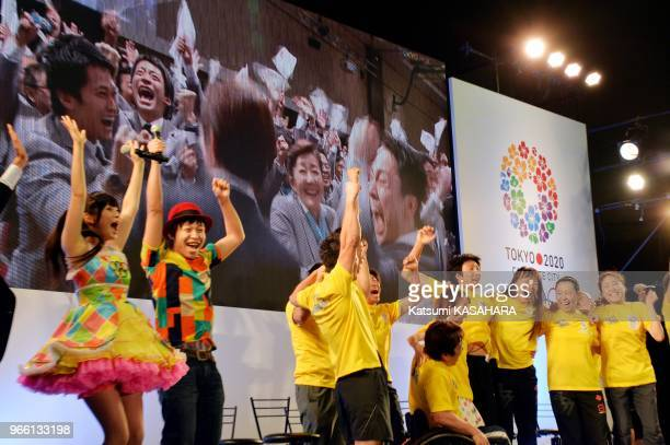 Japanese supporters celebrate after Tokyo won the bid to host the 2020 Olympics and Paralympics in the early morning on Sept 8th 2013