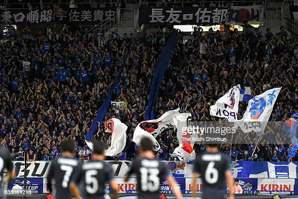 Japanese supporters celebrate their team's first goal during the international friendly match between Japan and Bosnia and Herzegovina at the Suita...