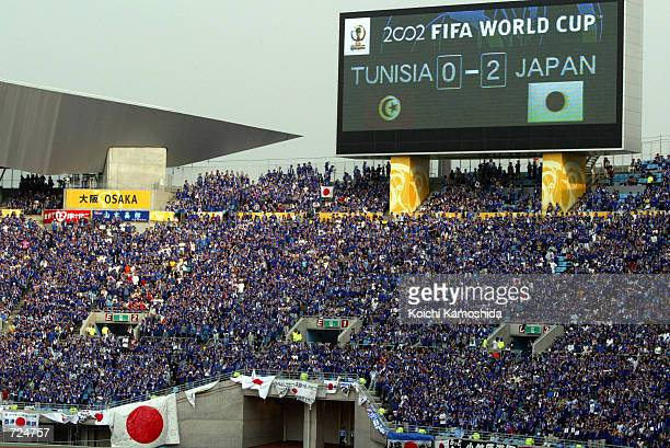 Japanese supporters cheer during a 2002 Federation Internationale de Football Association World Cup match between Japan and Tunisia at Nagai Stadium...