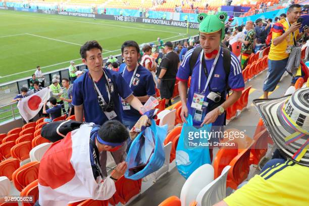 Japanese supporters clean the stand after the 2018 FIFA World Cup Russia group H match between Colombia and Japan at Mordovia Arena on June 19 2018...
