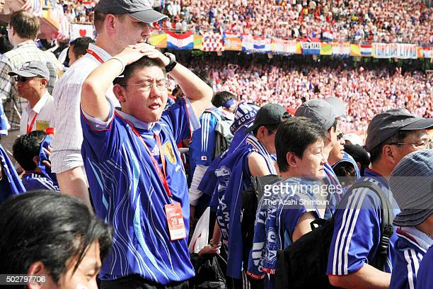 Japanese supporters react after their team's 00 draw in the FIFA World Cup Germany 2006 Group F match between Japan and Croatia at the Frankenstadion...