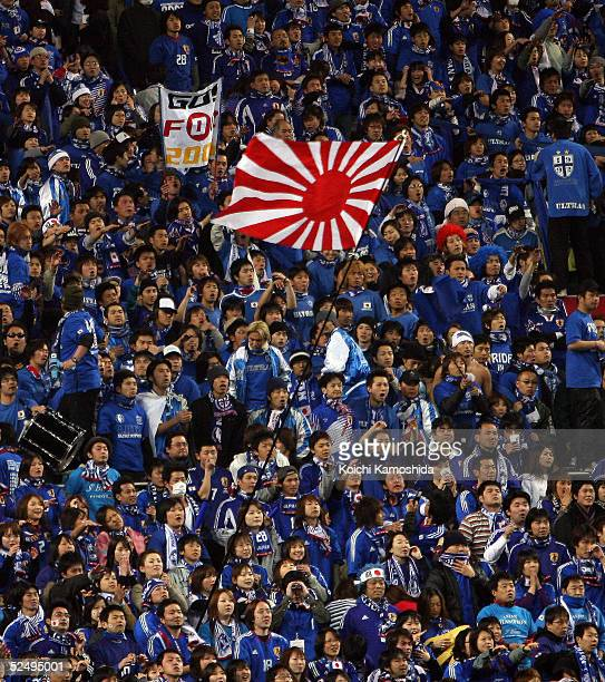 Japanese supporters wave a national flag during the 2006 FIFA World Cup Asian qualifying match between Japan and Bahrain at Saitama Stadium on March...