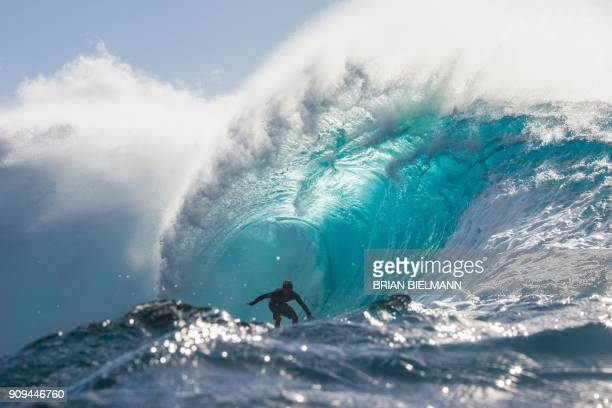 TOPSHOT Japanese surfer Wakita Takayuki rides the barrel during a late afternoon free surf session at the legendary Banzai Pipeline on the North...