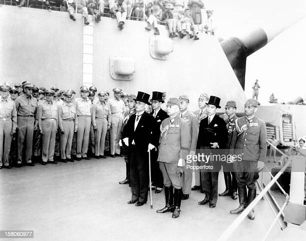Japanese surrender signatories, including Foreign Affairs Minister Mamoru Shigemitsu , arrive aboard the USS Missouri in Tokyo Bay to end World War...