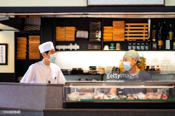 japanese sushi chefs wearing a masks for covid-19 - reopening stock pictures, royalty-free photos & images