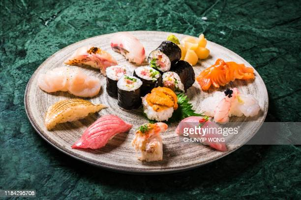 japanese sushi nicely presented in plate - japanese food stock pictures, royalty-free photos & images