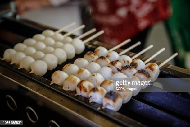 Japanese sweet rice dumpling ball Mitarashi dangoare seen displayed in inazawa Mitarashi dango is Japans traditional food and its very popular the...
