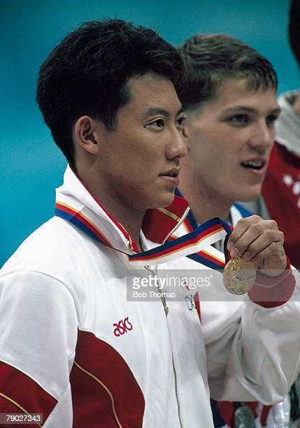 Japanese swimmer Daichi Suzuki stands on the podium after being awarded the gold medal after coming first in the final of the Men's 100 metres...