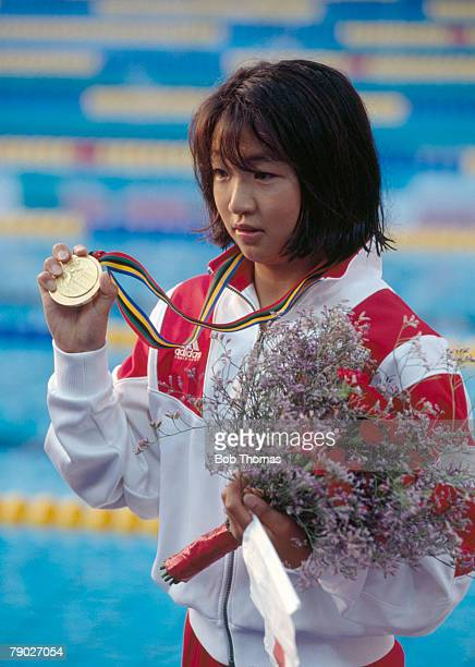Japanese swimmer Kyoko Iwasaki displays her gold medal on the podium after finishing in first place to win the gold medal in the final of the Women's...