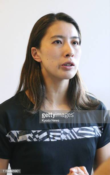 Japanese swimmer Yui Ohashi speaks upon her arrival at Narita airport near Tokyo on July 10 following highaltitude training in Flagstaff Arizona...