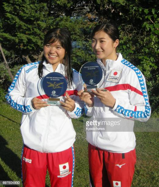Japanese swimmers Suzuka Hasegawa and Rikako Ikee pose for photos with their trophies in CanetenRoussillon France on June 18 after 17yearold Hasegawa...